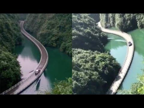 Amazing! Vehicle passes floating bridge with rising waves on river
