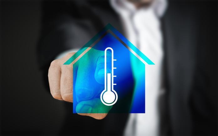 ikona hiše z termometrom